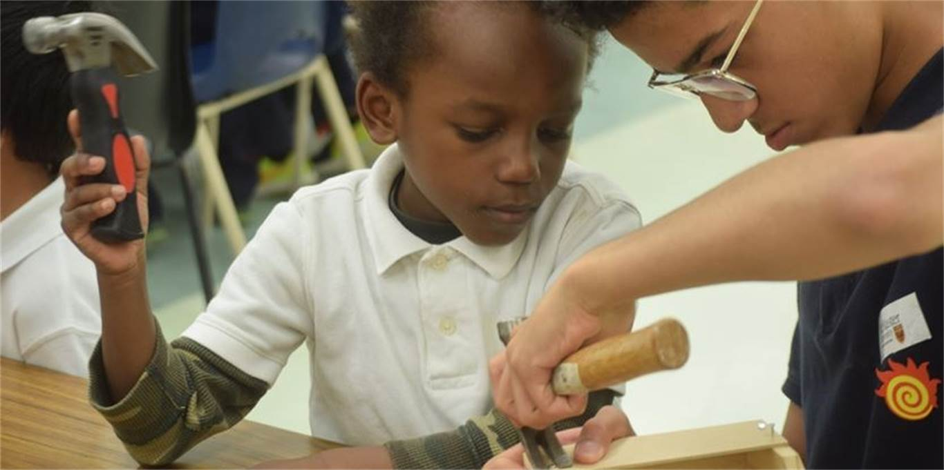 Kindergarten student Christian Nwaywu, left, gets help on his box from reading buddy and Grade 8 student Baazel Khan. Photo by Laura Lennie, Stoney Creek News.