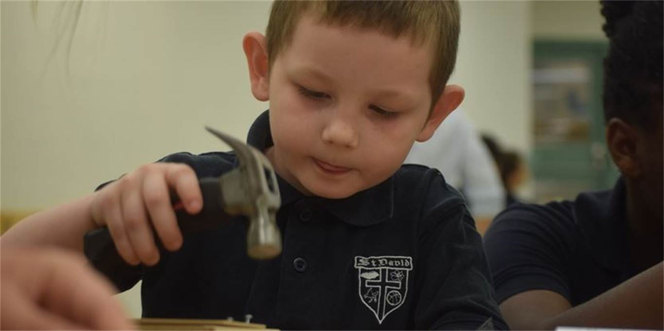 Kindergarten student Jacob Osmolinski hammers away at his box. Photo by Laura Lennie, Stoney Creek News.