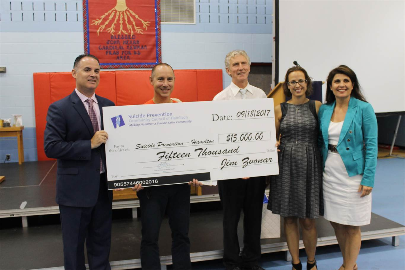 From left: Cardinal Newman Principal Dean DiFrancesco; Jim Zvonar; Sid Stacey, Chair of the SPCCH; Carla LaBella, Member of the SPCCH Board of Directors, Marisa Mariella, Cathedral Teacher and Member of the SPCCH Board of Directors.
