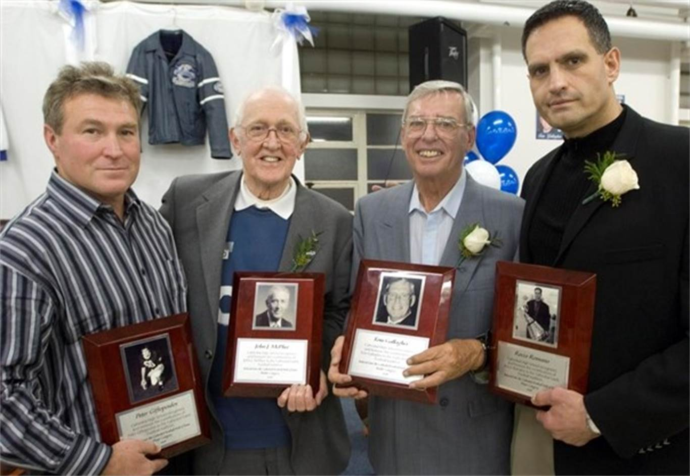 John McPhee was one of the first people that Cathedral High School inducted into its Gaels Hall of Fame in February 2008. Inducted were, from left, Steve Giftopoulos, accepting for his brother Peter, McPhee, Tom Gallagher and Rocco Romano. - Hamilton Spectator File Photo