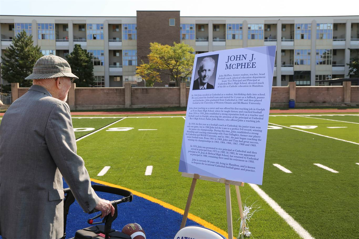 John McPhee looks out at the new artificial turf field at Cathedral High School named in his honour.