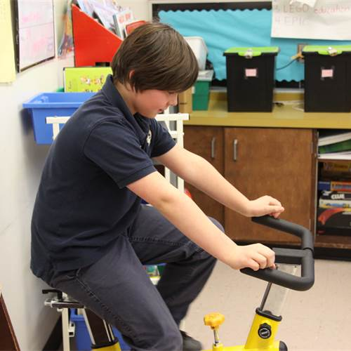 St. Anthony Daniel turns wheels in the classroom