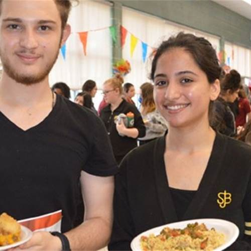 St. Jean de Brebeuf students Milad Darrouj (left) and Reham Al Akidi show off some Middle Eastern dishes they made as part of the school's eighth annual ESL Culturefest. Photo by Mark Newman, Hamilton Mountain News.