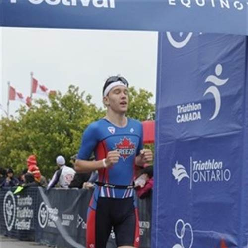 Waterdown triathlete Keven Brennan crosses the line at the Toronto Triathlon Festival on July 22. The 17-year-old Brennan finished second in his age group to qualify for the 2019 World Junior Triathlon Championships in Lausanne, Switzerland. Photo: Keven Brennan